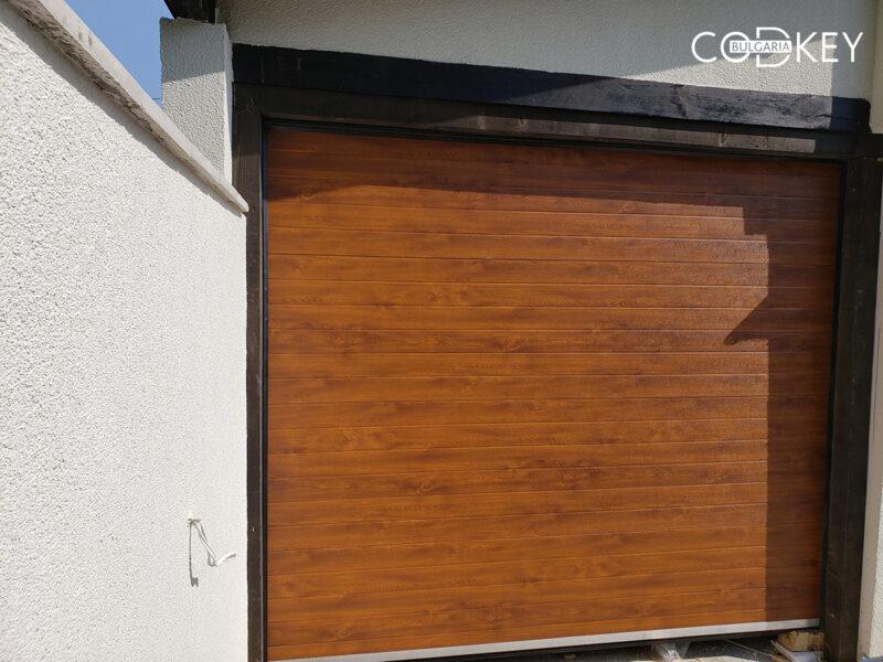 Гаражна секционна врата в село Белопопци_001
